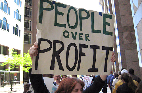 people over profit sign