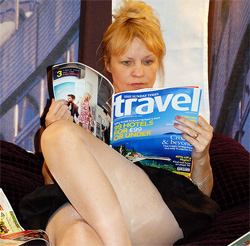 woman reading travel mag